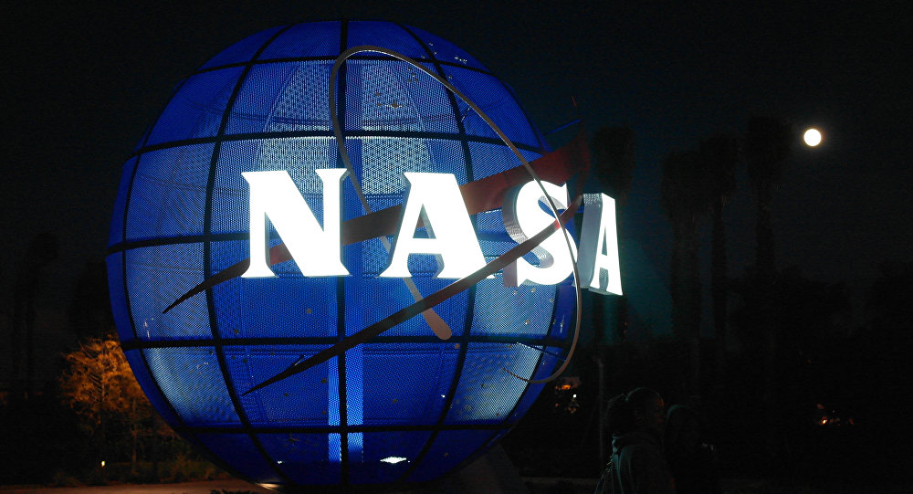 Blue Globe statue with glowing NASA logo